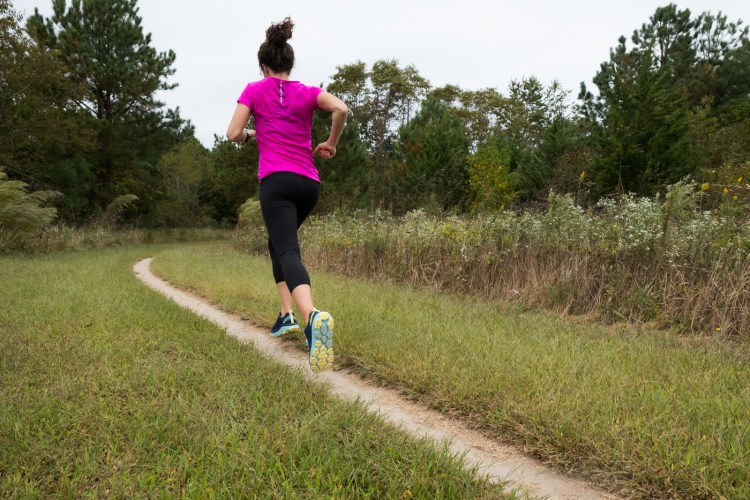 Caroline Whatley running in the Women's Hoka One One Challenger ATR 5 trail running shoes