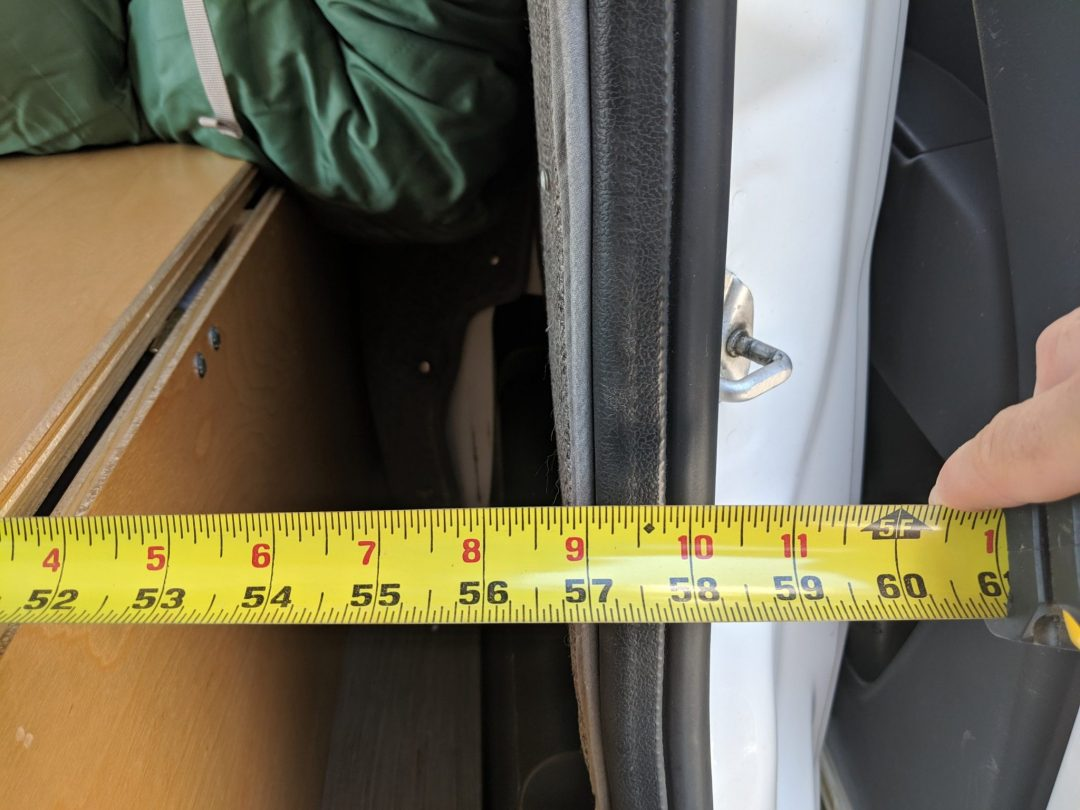 a tape measure of the DIY van life bed