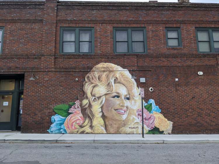 Best Instagram Spots in Asheville: West Asheville mural of Dolly Parton by Gus Cutty