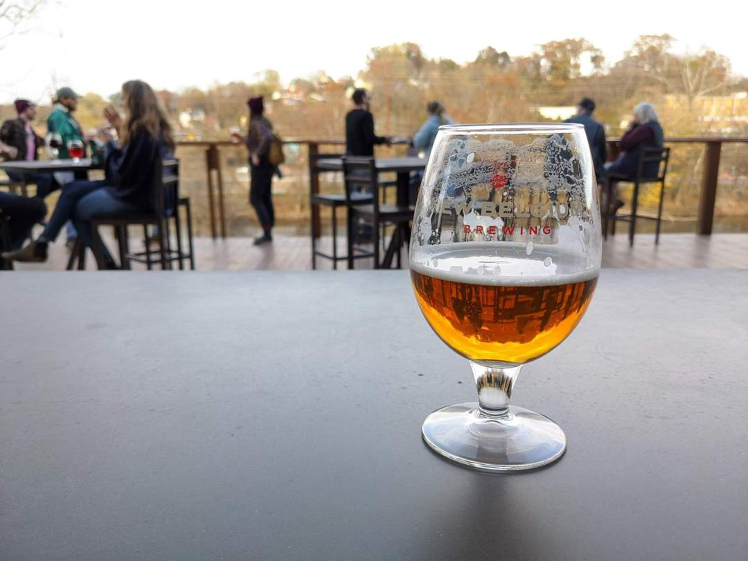a photo of a beer at New Belgium Brewing Company, one of the best outdoor breweries in Asheville.