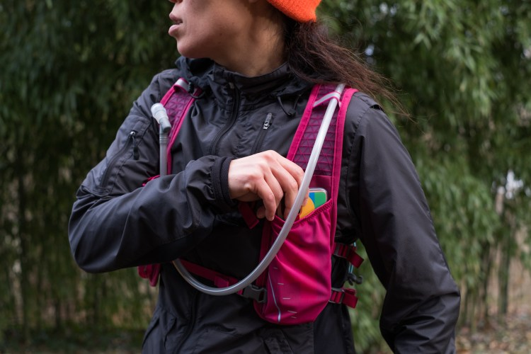 Photo of the front pocket of the Nathan TrailMix 7 Liter Women's Multi-Adventure Vest which is large enough to store a phone, map or gels.