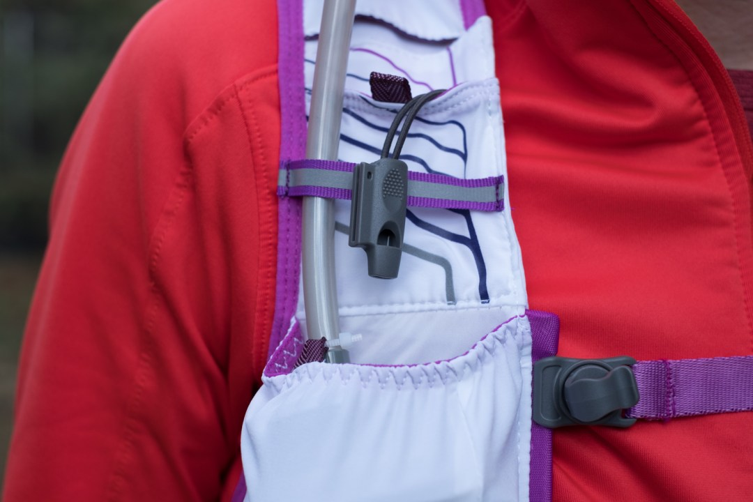 A photo of the safety whistle on the VaporHowe 4L 2.0 Ultralight Race Vest