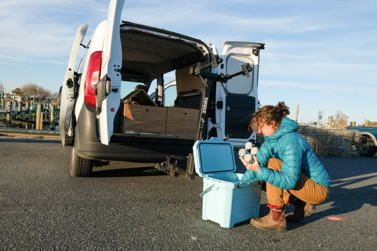 photo of a woman cleaning out a van