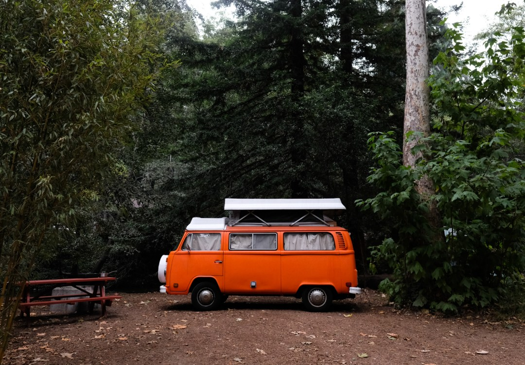 an orange VW camper van