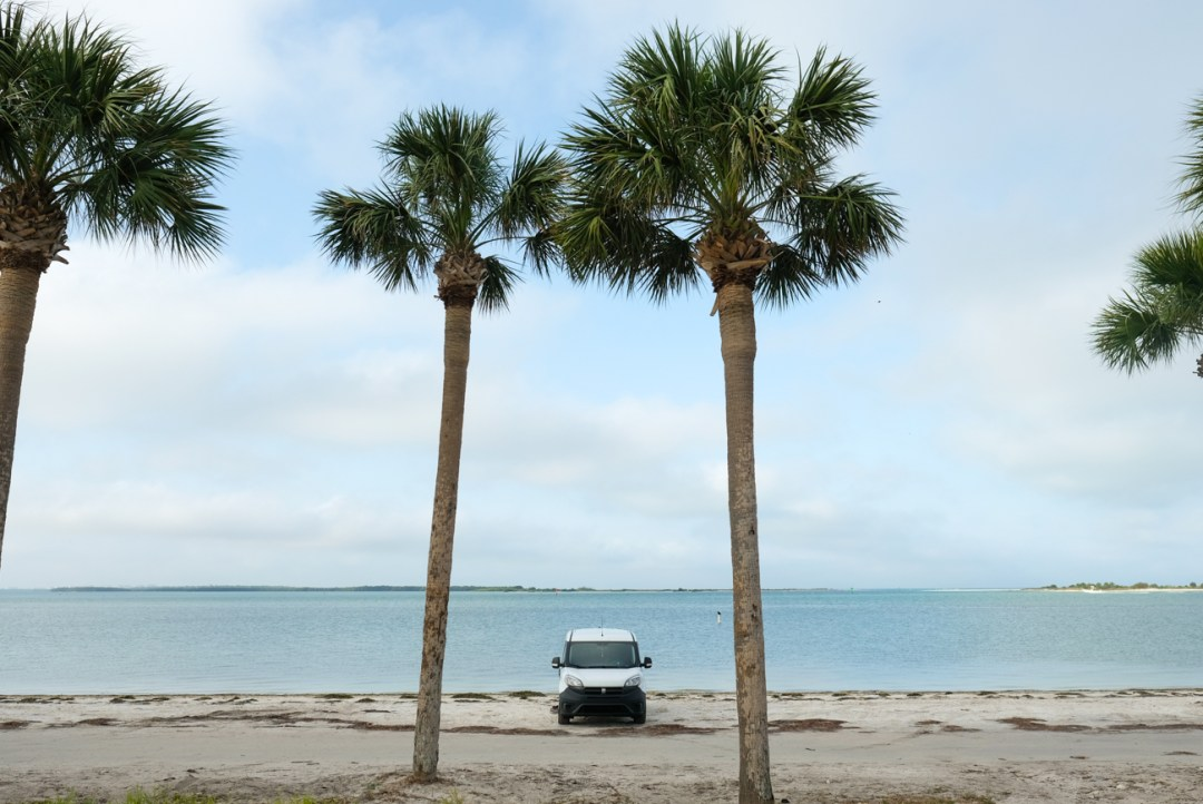 a ram promaster city camper van next to the beach in Florioda