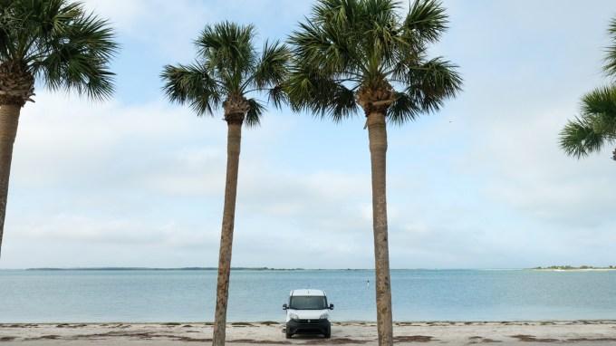 a ram promaster city camper van next to the beach in Florioda
