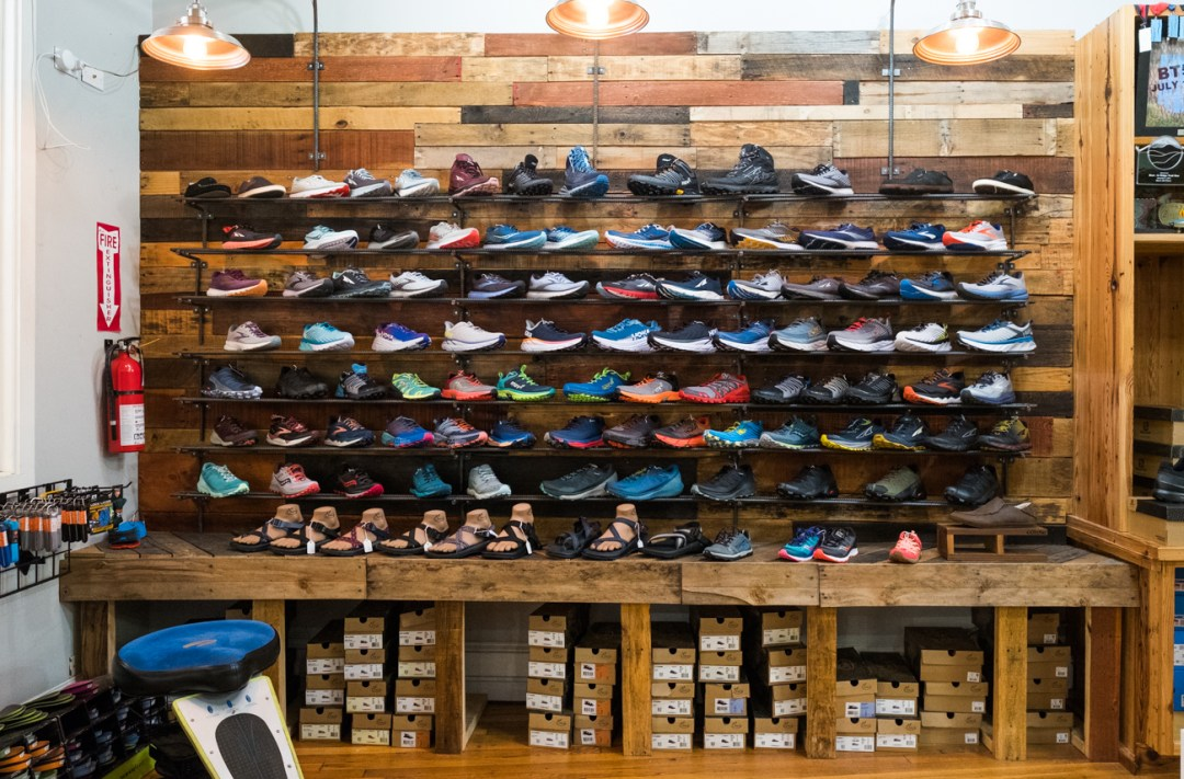a photo of the shoe display wall inside Vertical Runner in Black Mountain, NC.
