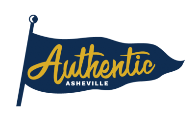 A logo with a dark blue flag representing the Blue Ridge mountains, with the words Authentic Asheville in gold and white.