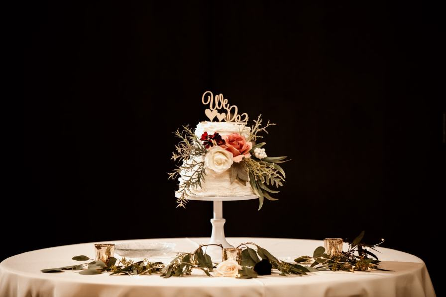 Wedding Cake on a table with roses