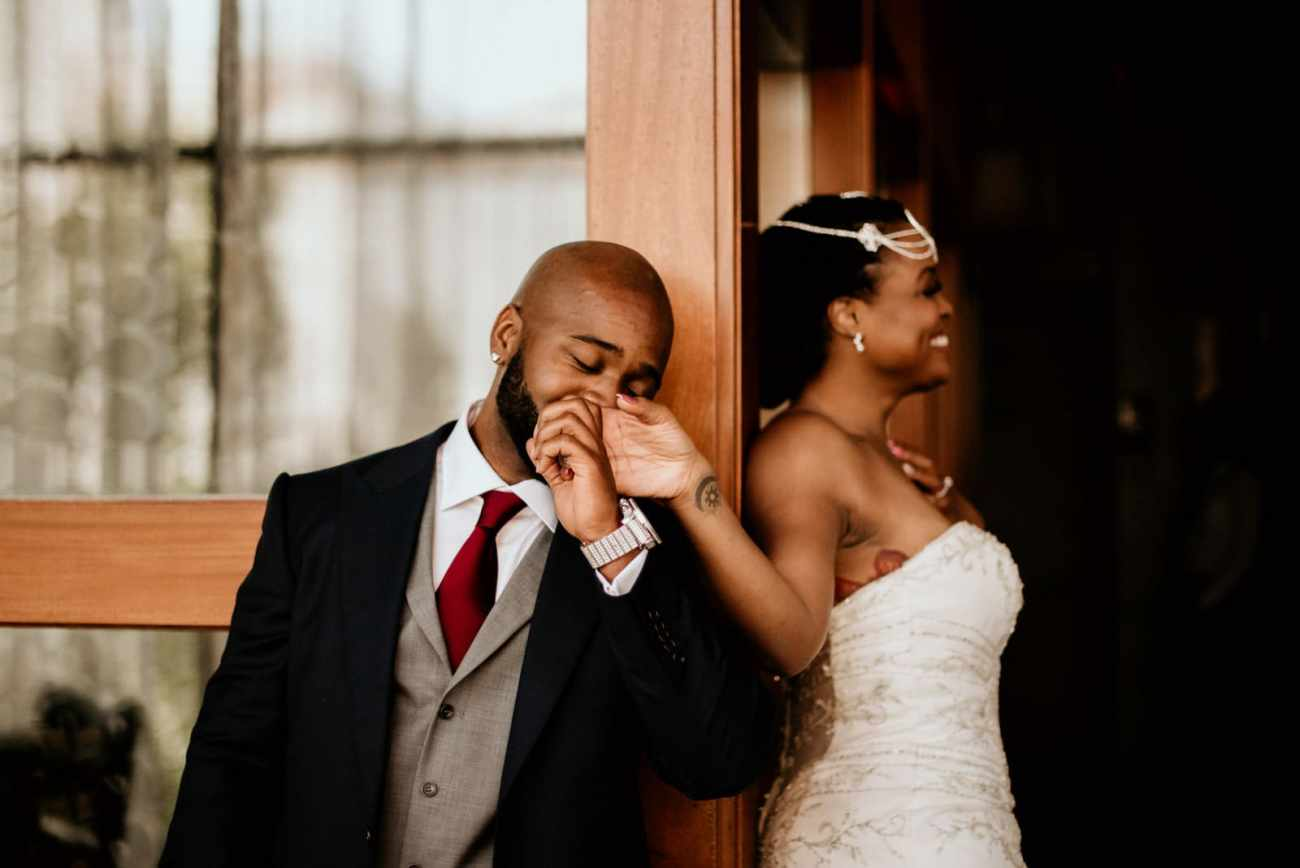 Groom kissing the brides hand prior to the first look