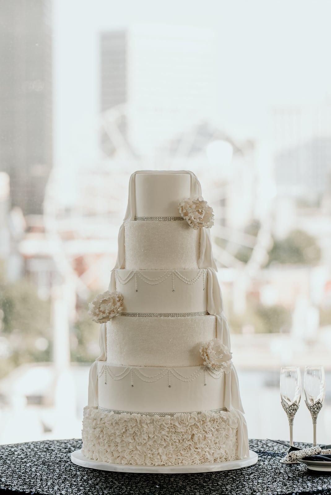 Draped wedding cake with Skyview Atlanta ferris wheel in the background