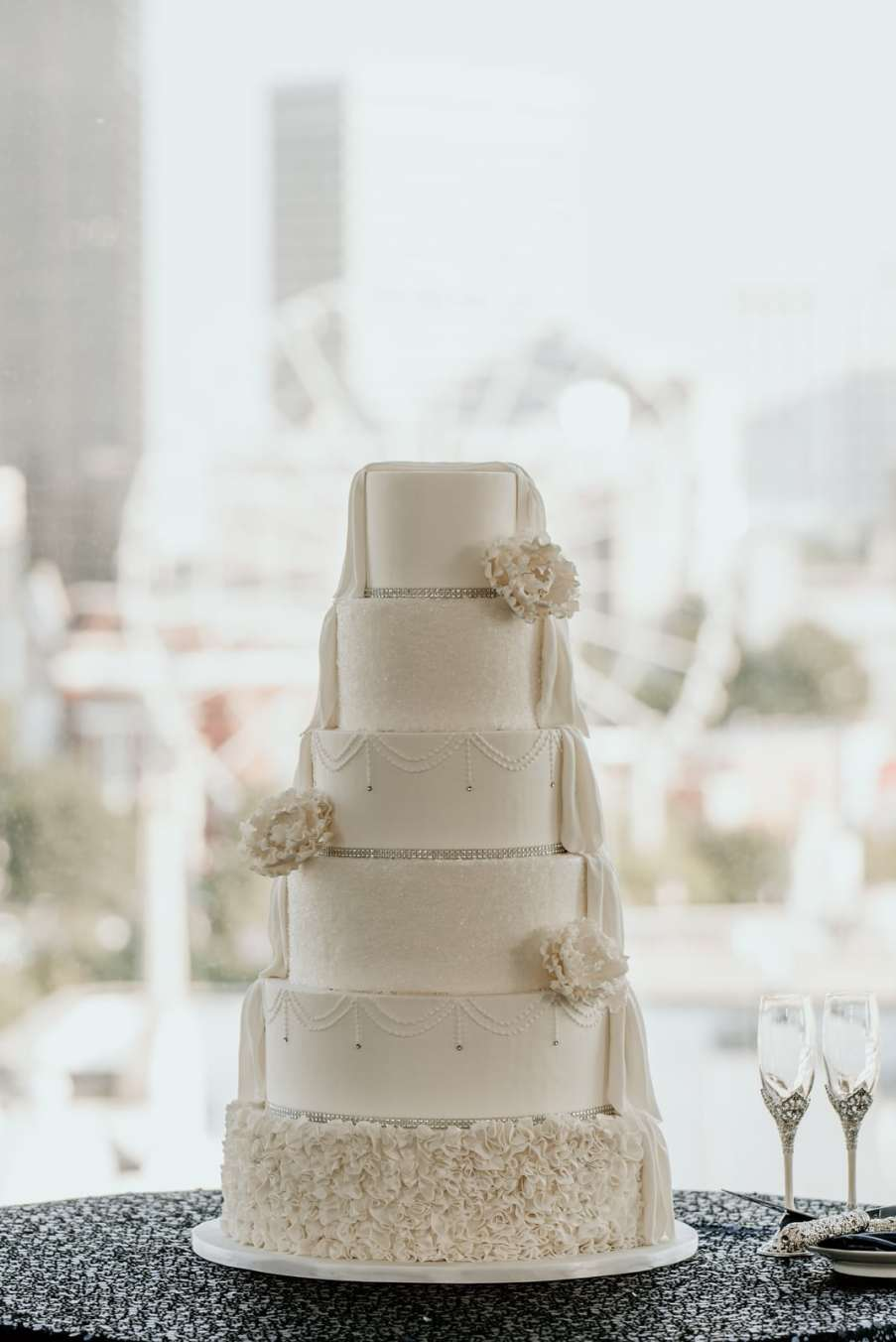 Draped wedding cake with Skyview Atlanta ferris wheel in the background
