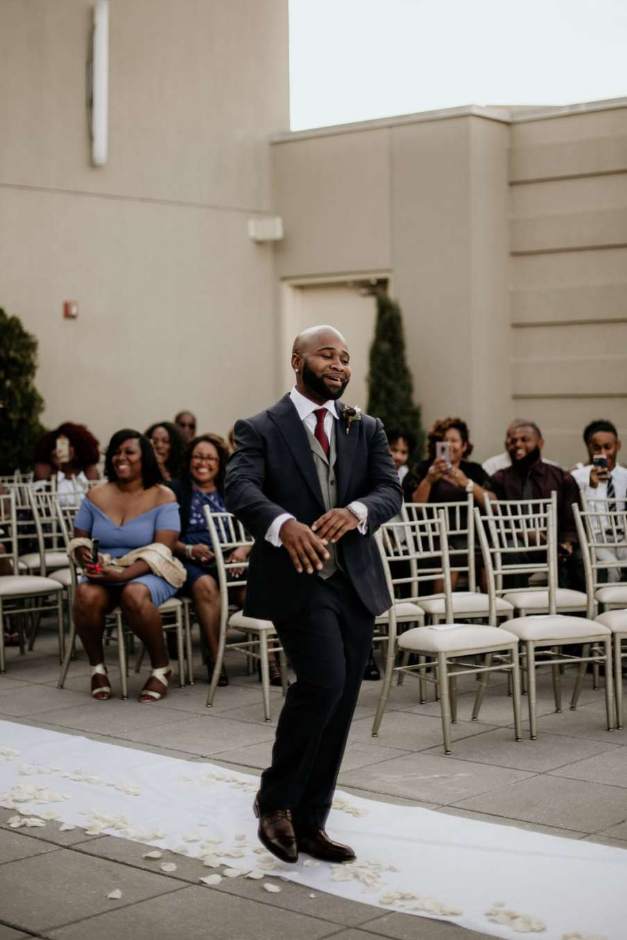 Groom dancing in the aisle