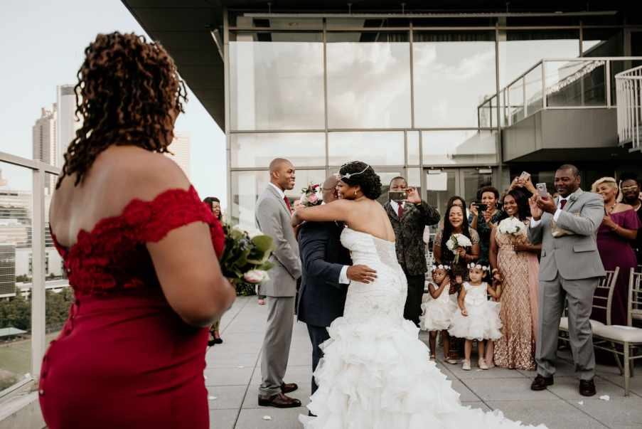 Bride and Groom embrace Ventanas