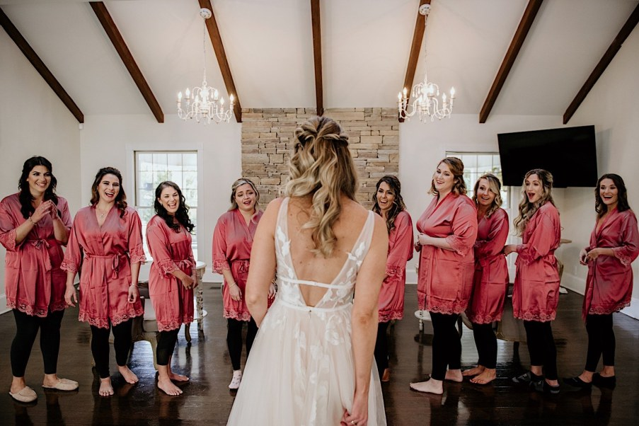 Wedding day bride dress reveal with bridesmaids