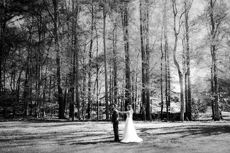 Wedding day first look with bride and groom outside in nature