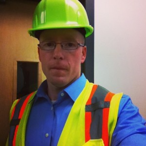 Christoph in safety vest and hard hat