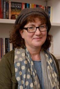 Headshot of Debbie in a bookshop