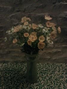 Ikea artificial flowers in green glass vase