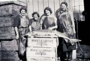 Girls processing fish
