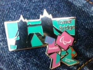 Official enamel pin badge showing Tower Bridge, supporting the London 2012 Olympics