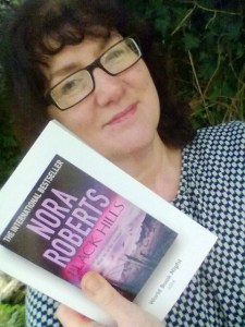 Photo of Debbie Young with her chosen book for World Book Night 2014