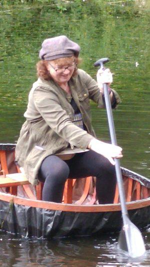 Debbie paddling a coracle