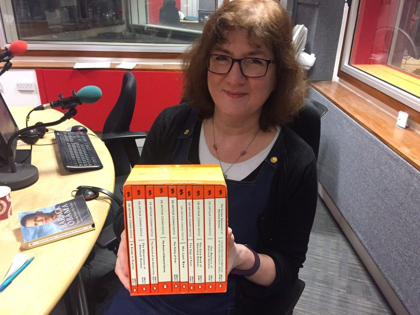 Photo of Debbie holding a box set of Sherlock Holmes books