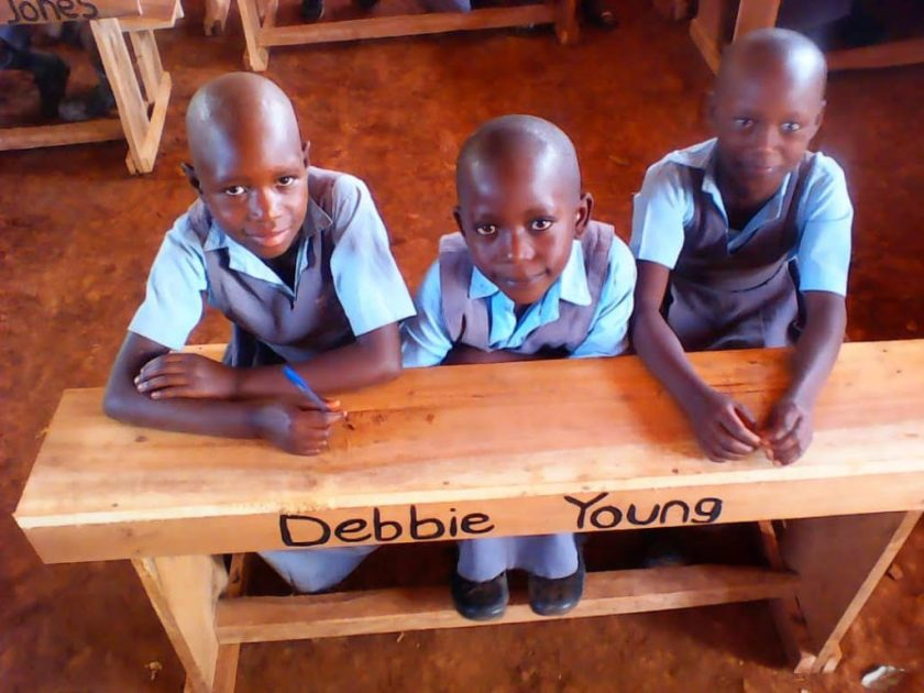 photo of children at desk with Debbie Young's name on