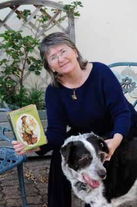 photo of Jean Gill with book and dog