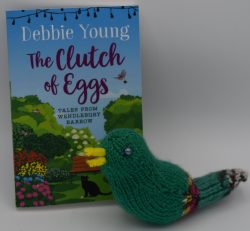 knitted bird with book