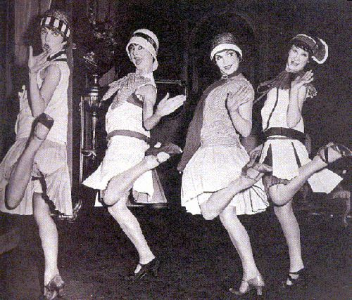 photo of four flappers dancing