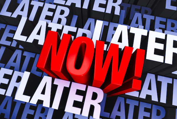 "A bold, red ""NOW!"" emerges from a multi-level background made up of multiple instances of the word ""LATER"""