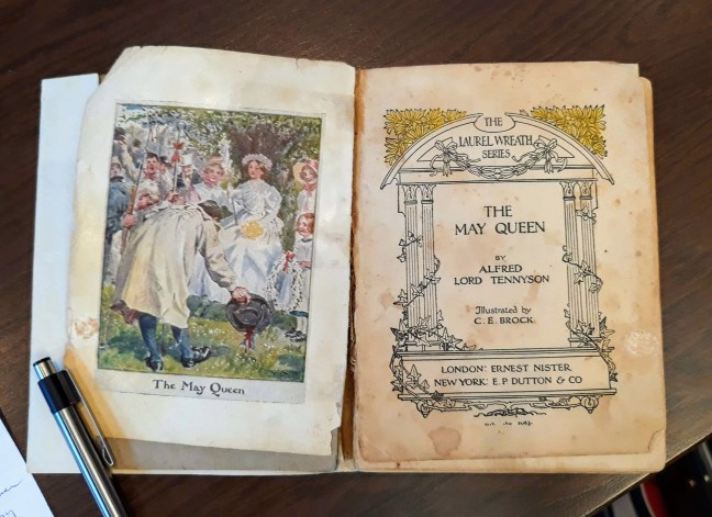pages from book of lord alfred tennyson's poem the may queen