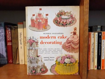 book cover modern cake decorating pictorial encyclopedia on bookshelf