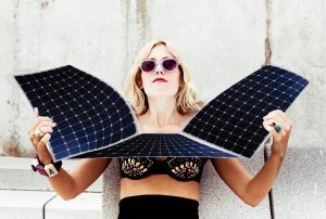 blonde woman using solar panels as reflective for sunbathing