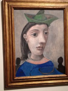 Picasso's woman with a green hat