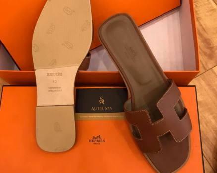 Dán đế giày dép Hermes 16