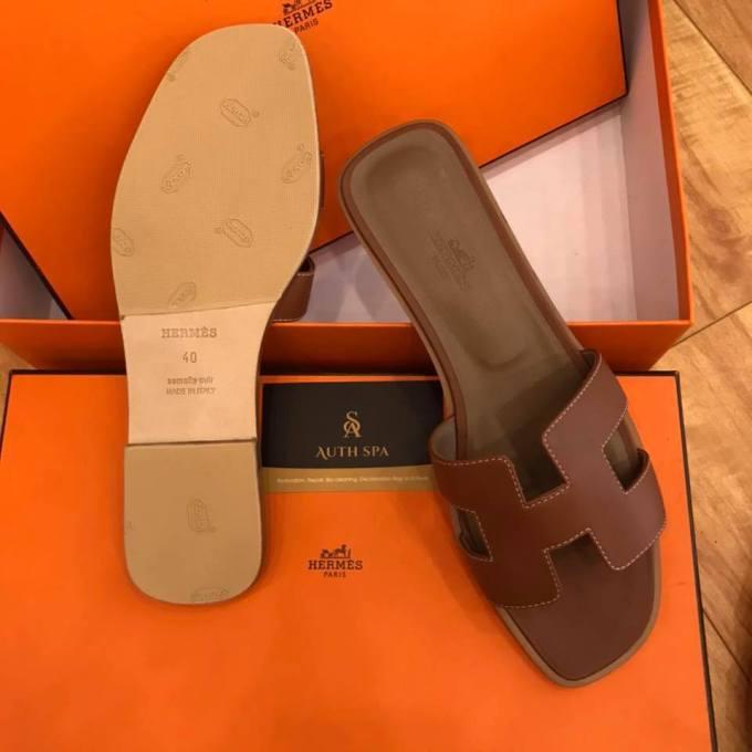 Dán đế giày dép Hermes 14