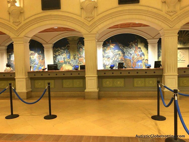 Disney Coronado Springs Resort Tips for Families murals behind the check in