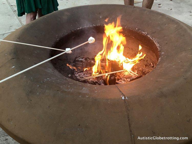 Disney Coronado Springs Resort Tips for Families roasting marshmallows in the fire