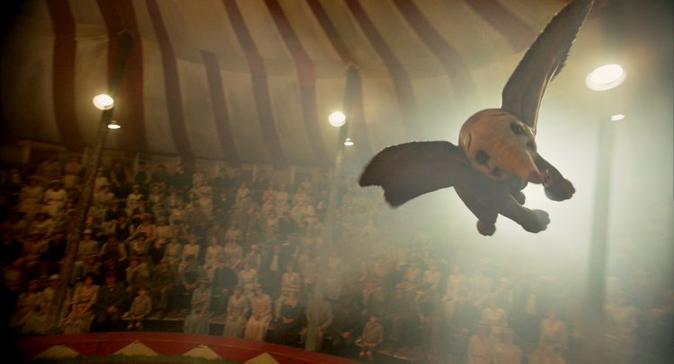 Tim Burton's Dumbo Soars Captivating Audiences of all Ages flying