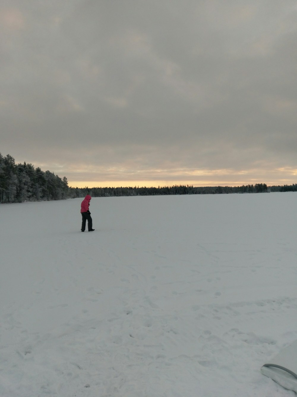 The feature image for the blog, kids on tour - autism without limits. A girl walks across a frozen lake in Lapland.