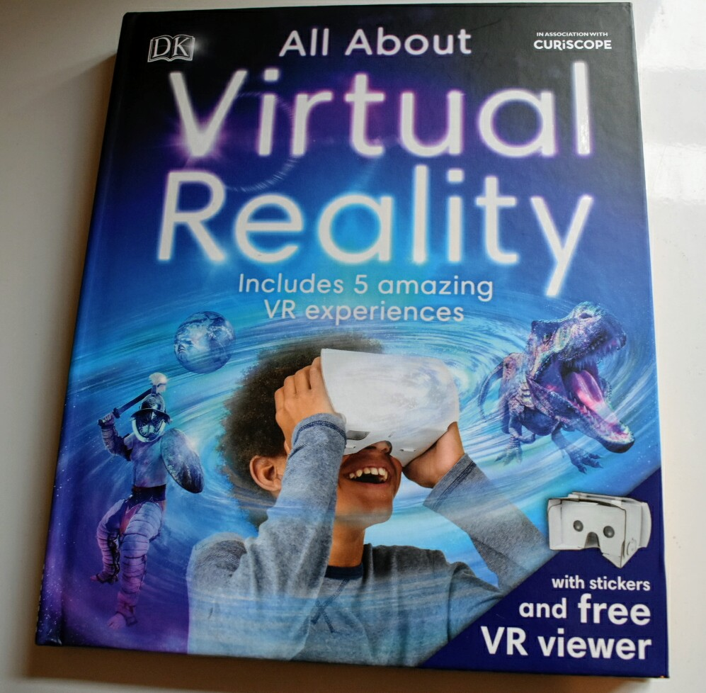 A book called All About Virtual Reality. The picture on the front is of a child with a Virtual Reality viewer