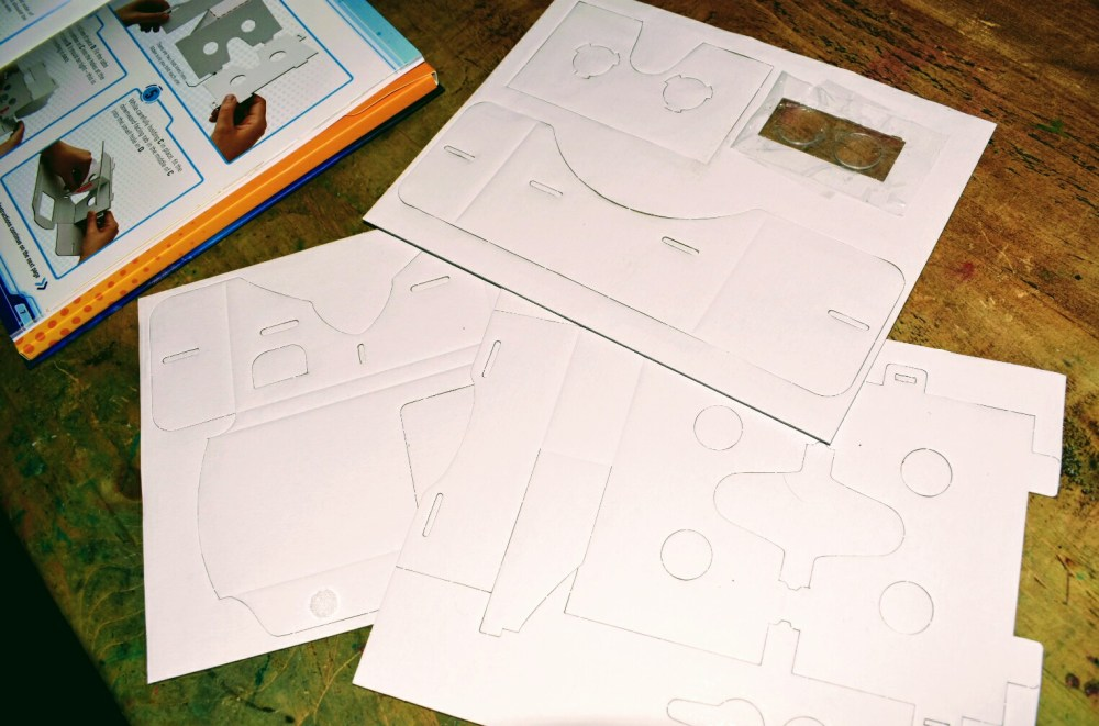 Cardboard cut outs forming a ready to make Virtual Reality viewer.