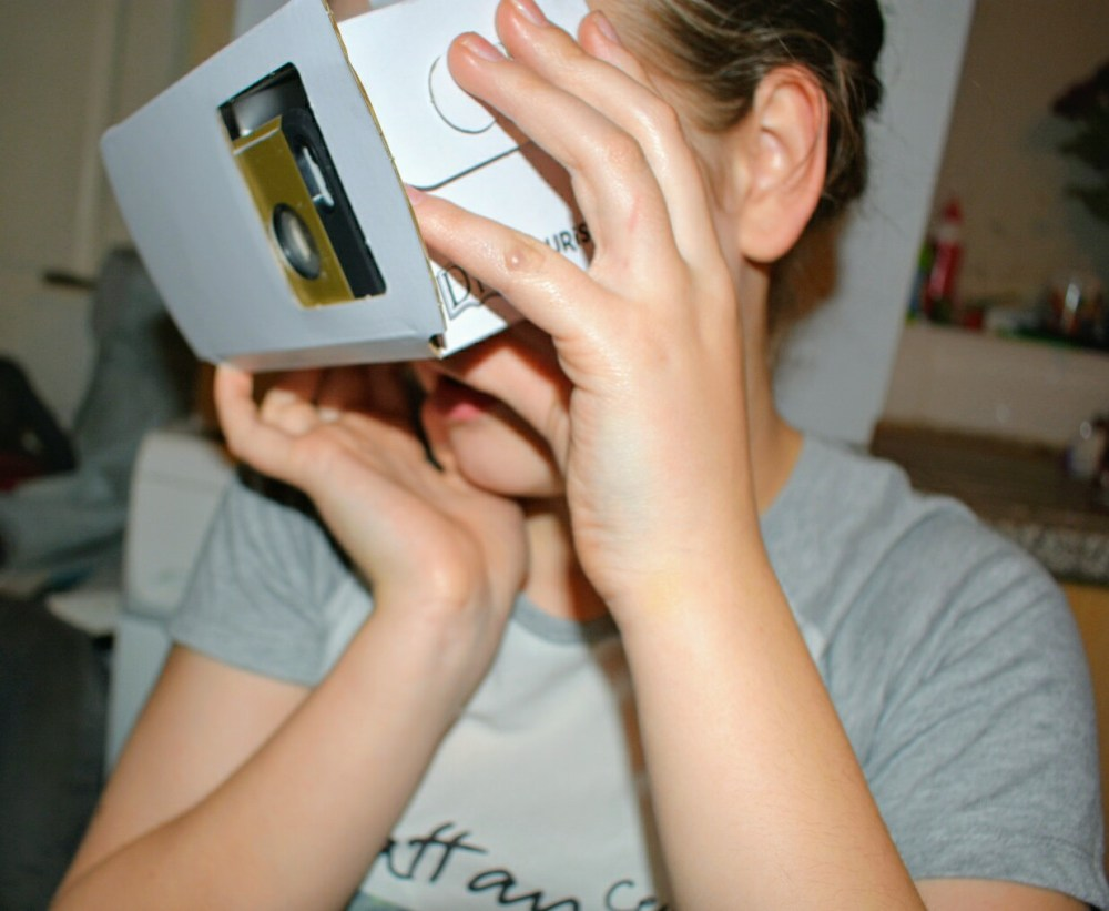A child looking into a Virtual Reality viewer.