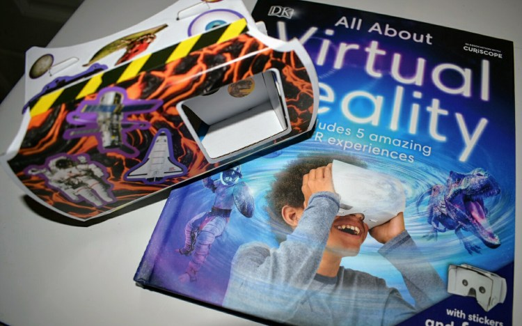 A book called all about virtual reality and a homemade virtual reality viewer decorated with stickers