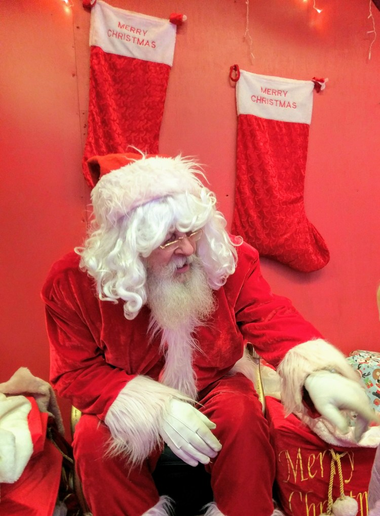 A man dressed as Father Christmas.