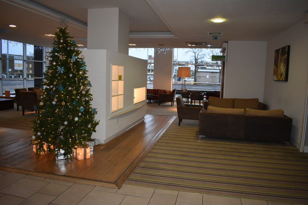 A large hotel reception area with Christmas tree