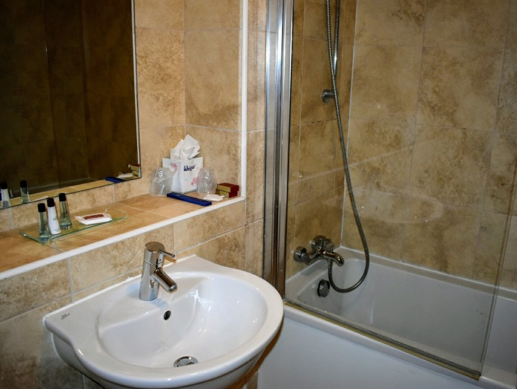 A sink and bath with shower